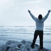 Young Man Worshiping at the Beach