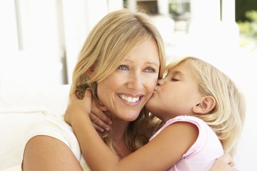 Daughter Giving Mother Kiss