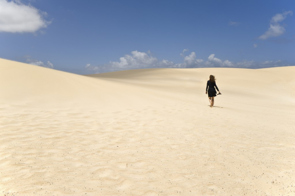 A Girl walking along the dunes