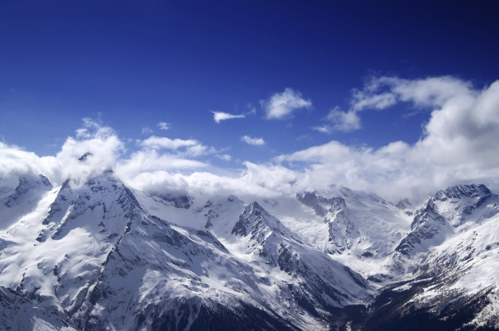 Snowy mountains at sun day