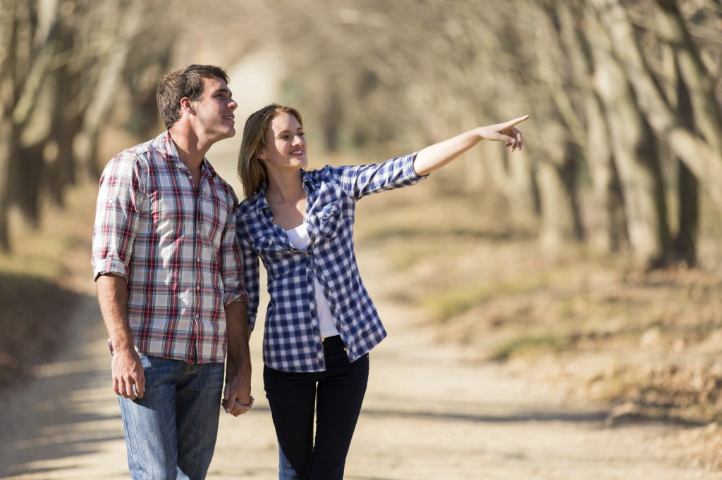 happy couple walking outdoors in fall