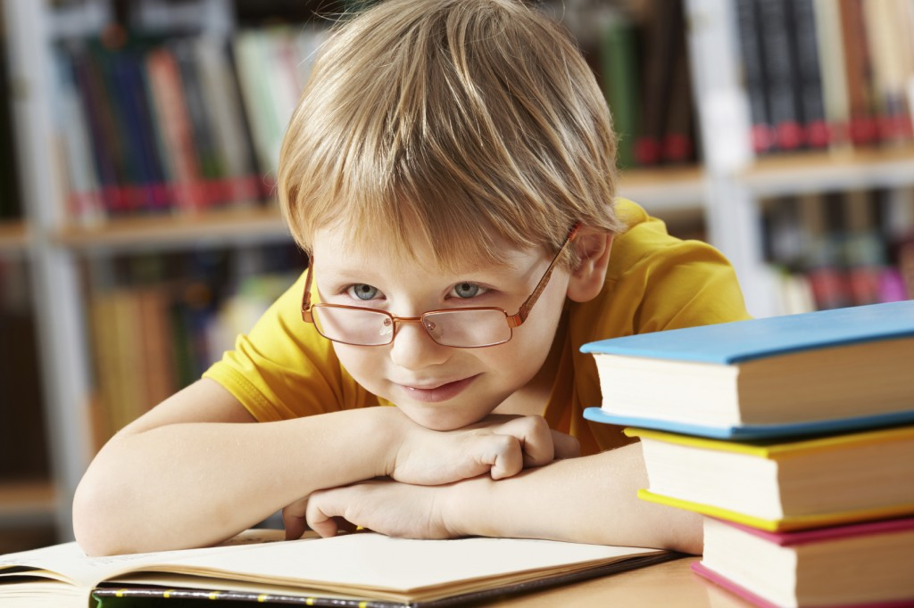 boy with open book in library
