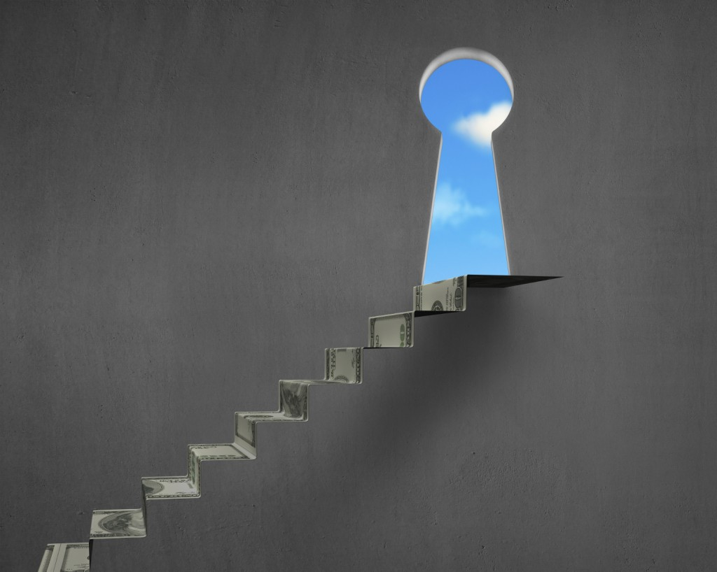 Money stairs with key hole and blue sky