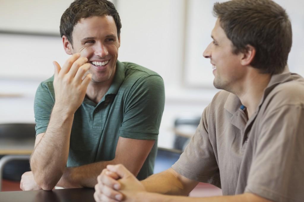 Two friendly men talking