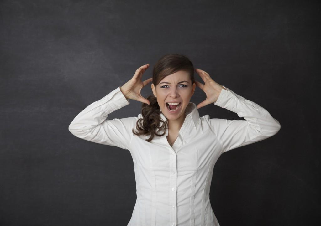 Woman screaming blackboard/chalkboard concept