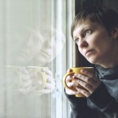 Lonely woman drinking cup of coffee