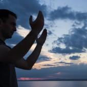 Silhouette of a praying man