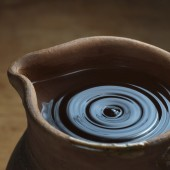 Rustic clay jar with water