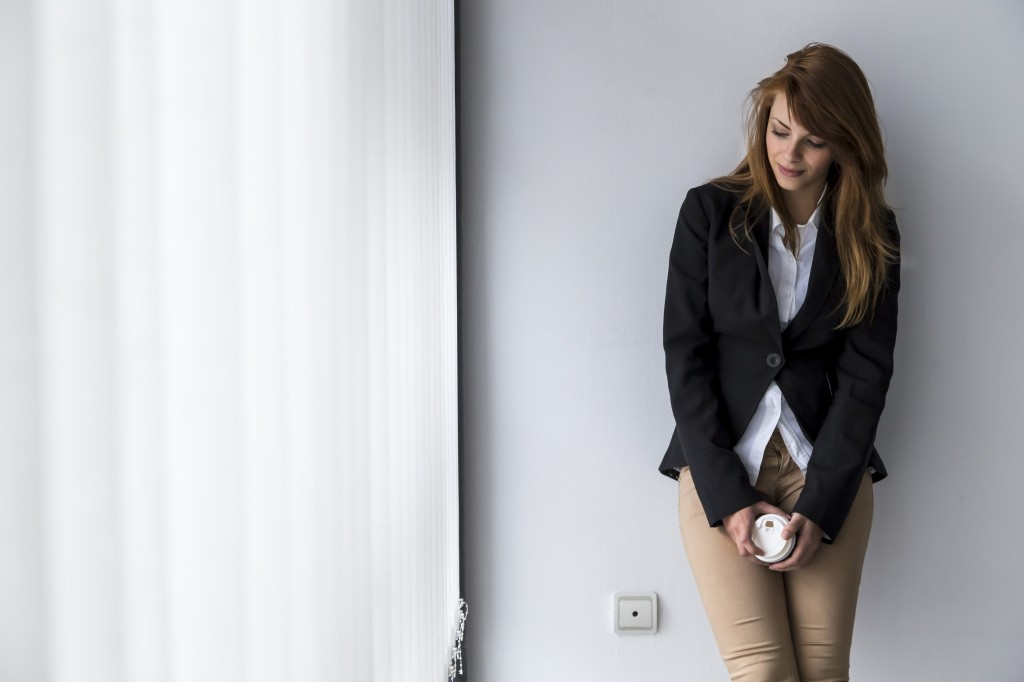 Young successful business woman on a coffee break