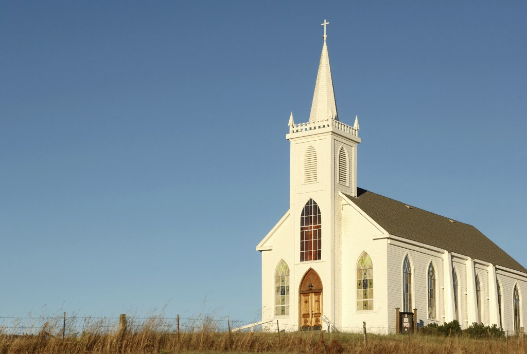 White, steepled church against a clear blue sky