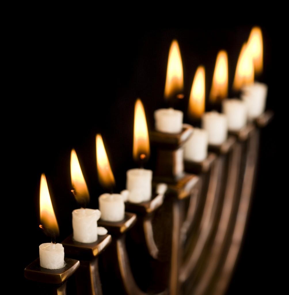 Beautiful lit hanukkah menorah on black. Super black background