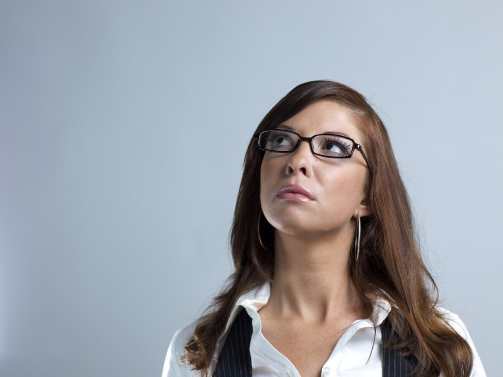 A young woman looks up and wonders what is up there.
