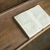 Open bible on pew in small church