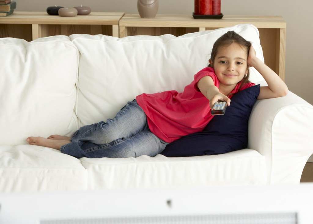 Young Girl Watching Television at Home