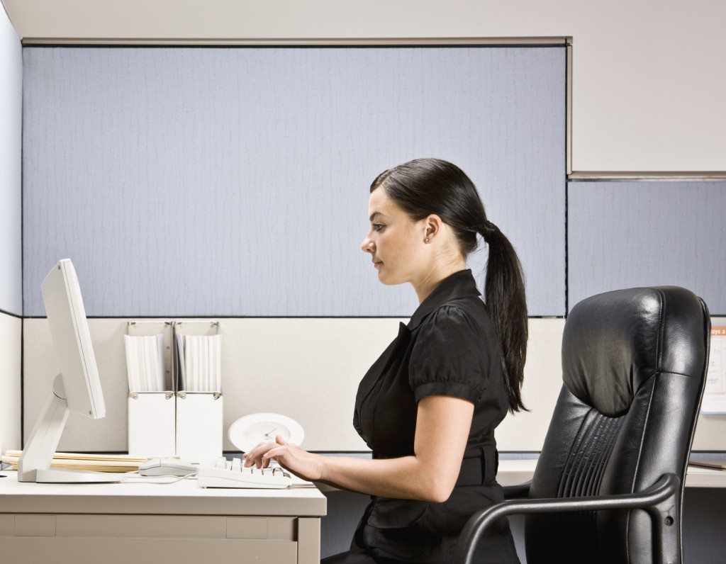 woman sitting at desk with good posture