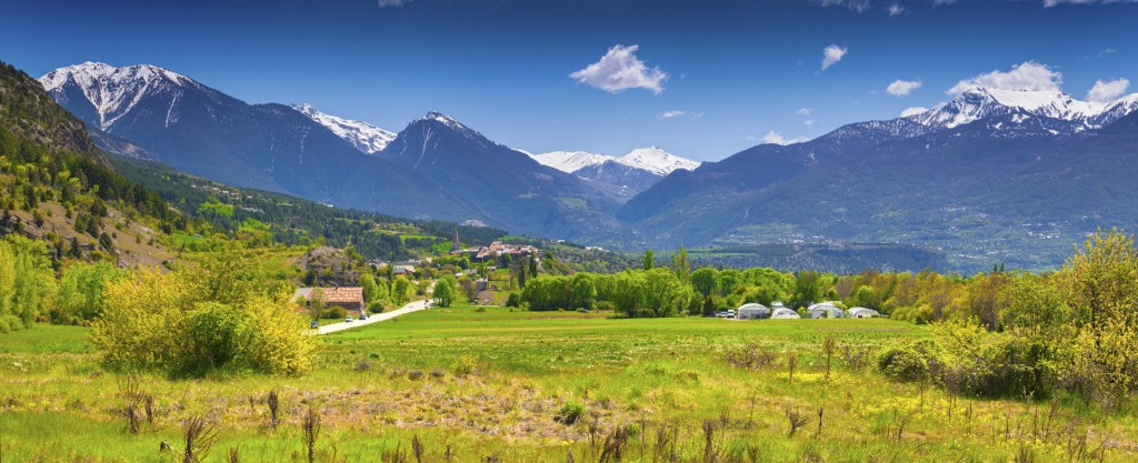 Panorama of the French Alps in the sunny summer morning