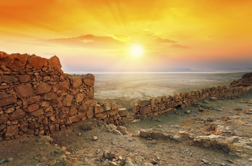 Beautiful sunrise over Masada fortress in Judaean Desert