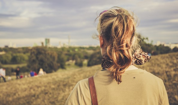 Young woman admiring view from a hill