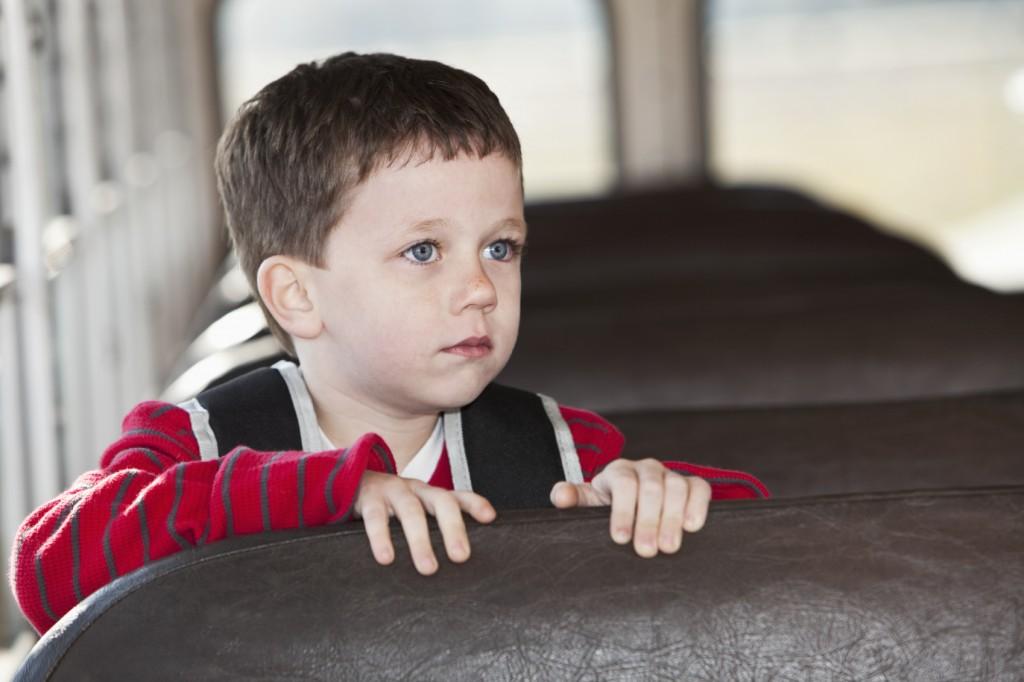 Boy riding school bus