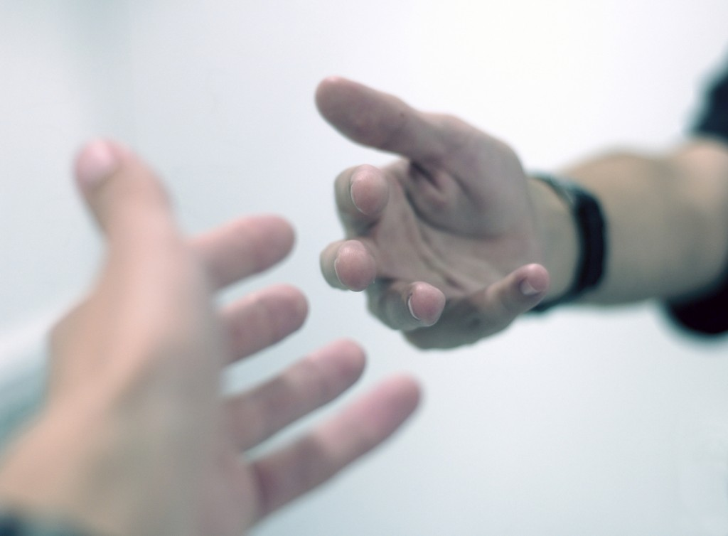 hands reaching out in service