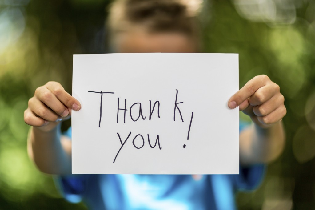 Boy with Thank You sign