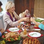modern family of four having festive dinner on Thanksgiving day