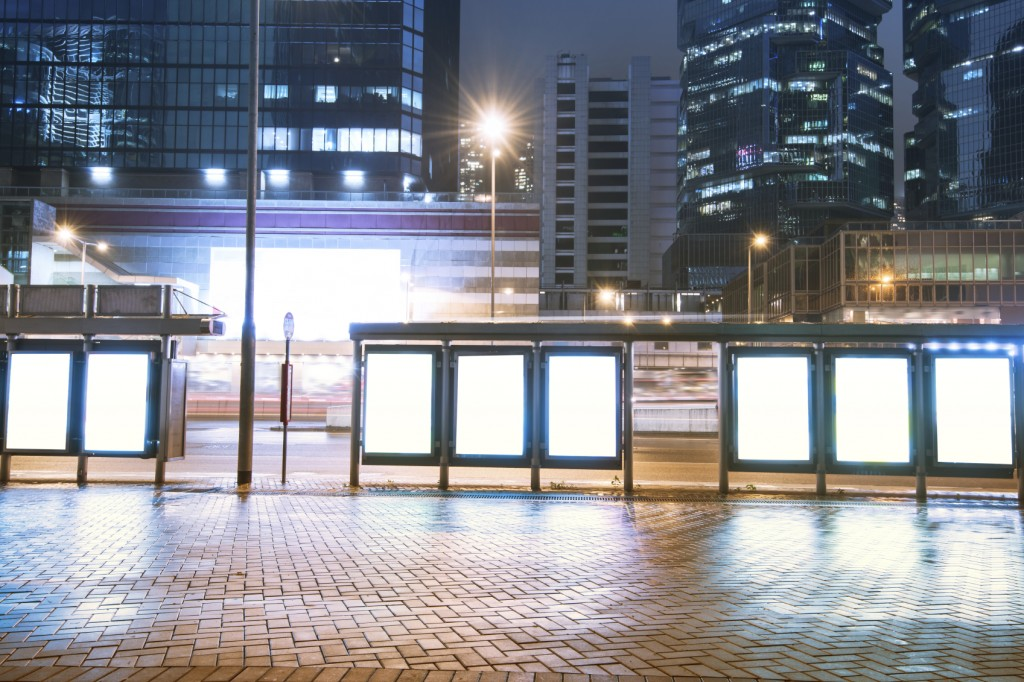 Billboards, bus station, city at night