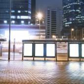 Billboards, bus station, city at night