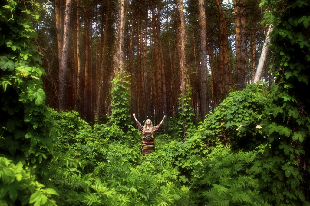 Girl worshipping in the Forest