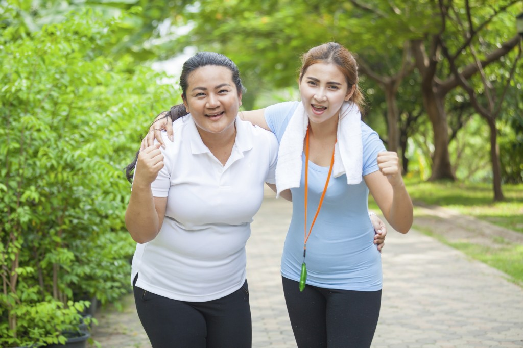Portrait of two fit young women smiling