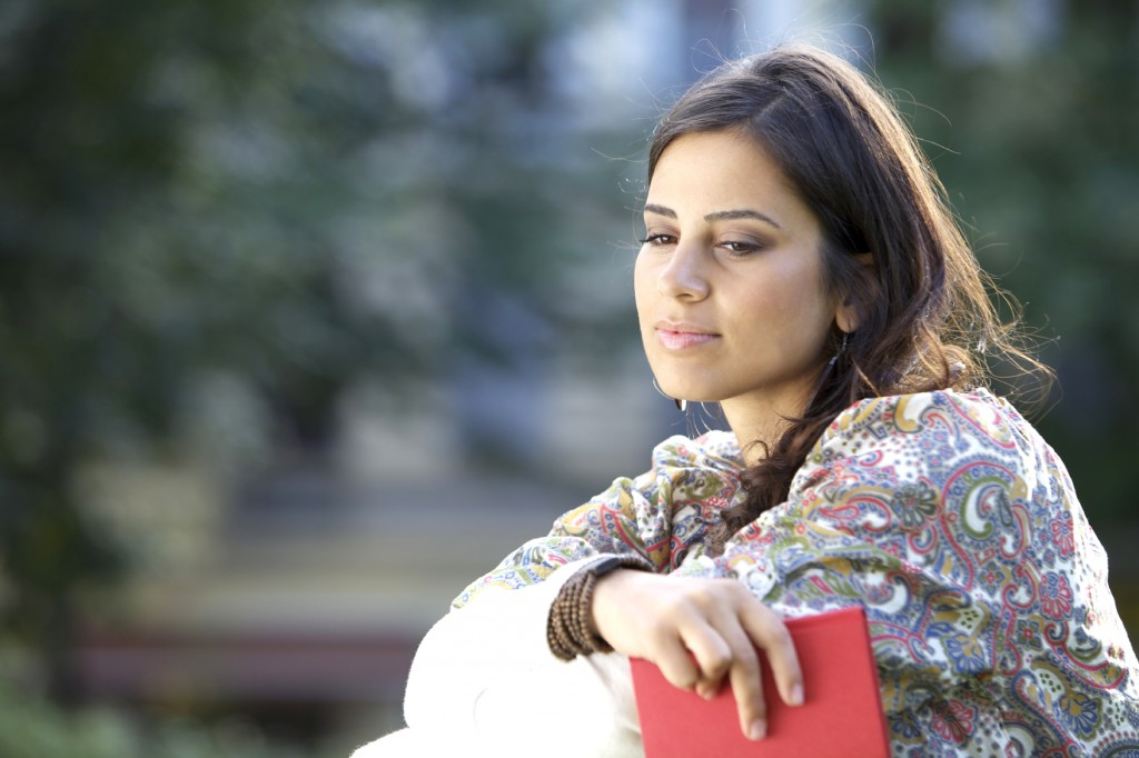 Woman thinking outdoors