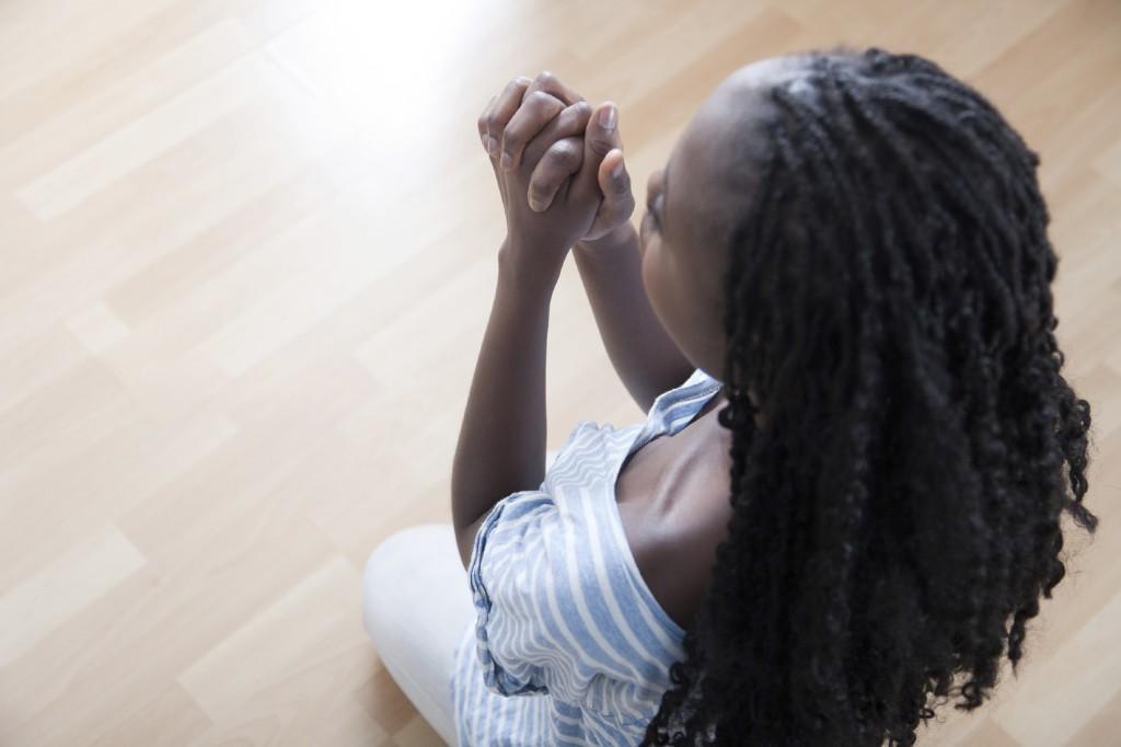 Young African Woman Praying