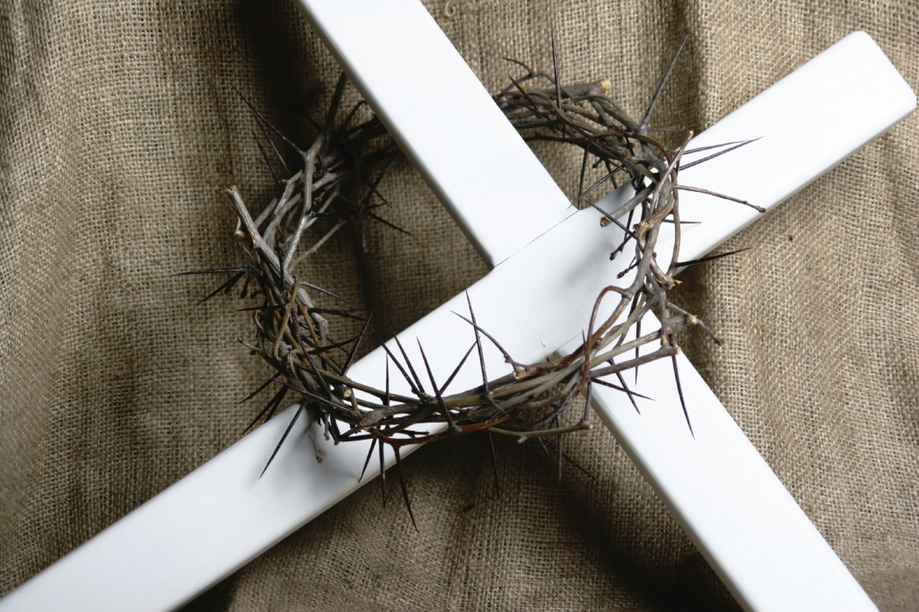 a rown of thorns resting on a cross