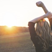 Carefree woman watching sunset