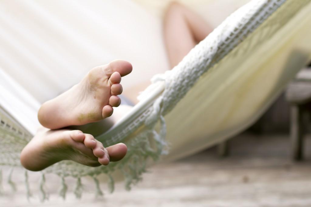 Child relaxing in hammock