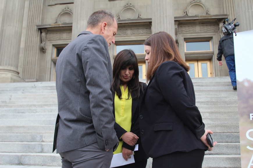 Pastor Saeed Abedini's wife, Naghmeh, prays with a local friend and pastor