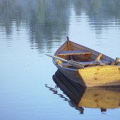 small boat sitting on calm water
