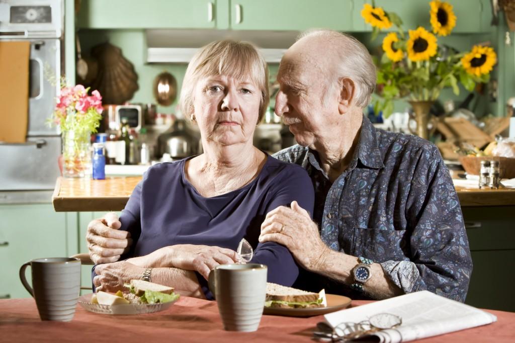 Senior Sad Senior Couple in their Dining Room