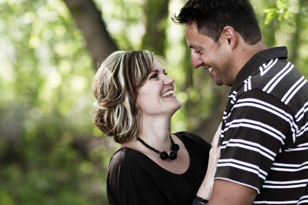middle aged couple looking up at each other and smiling.