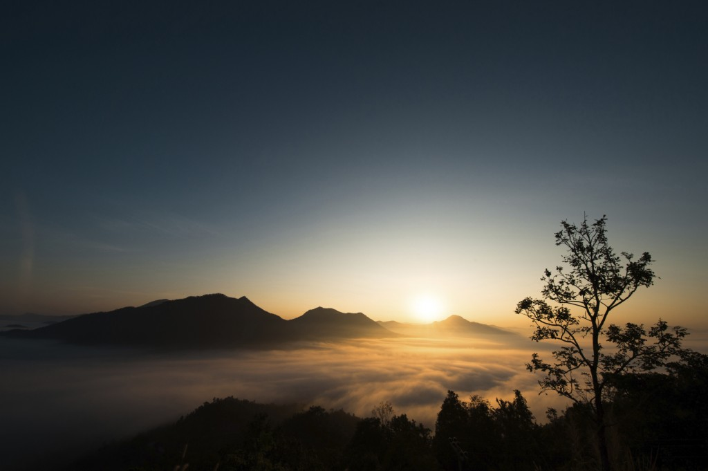 early morning sunrise over a mountain
