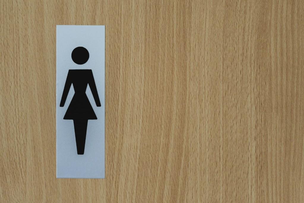 womans bathroom door sign