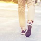 woman walking along a sunny road