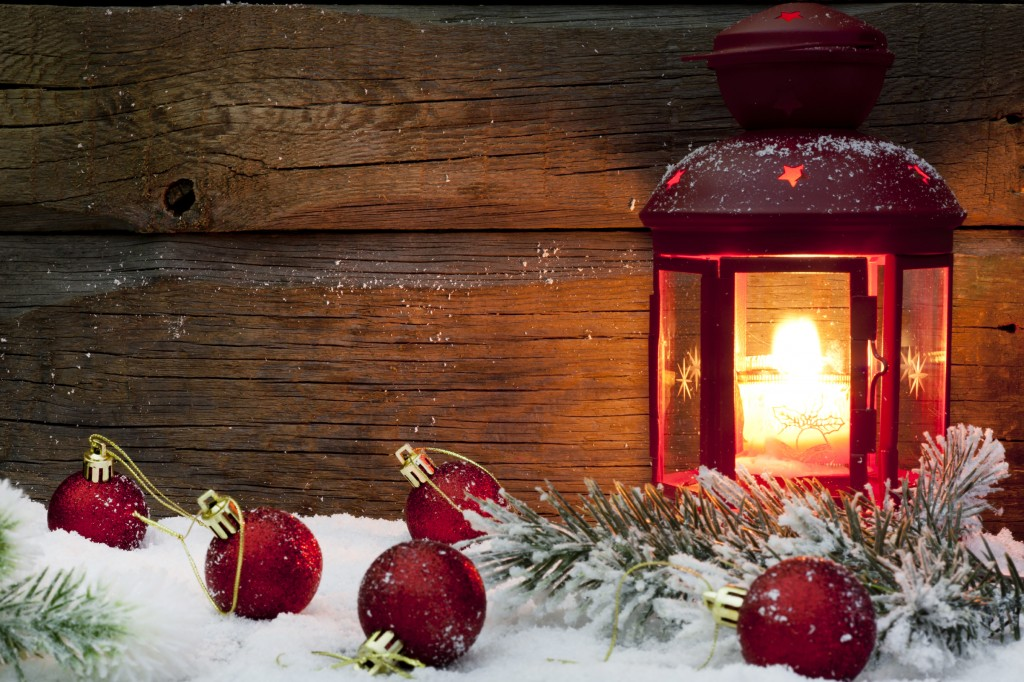 lantern and Christmas decorations set in snow.