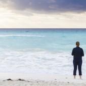 woman facing the ocenan's waves