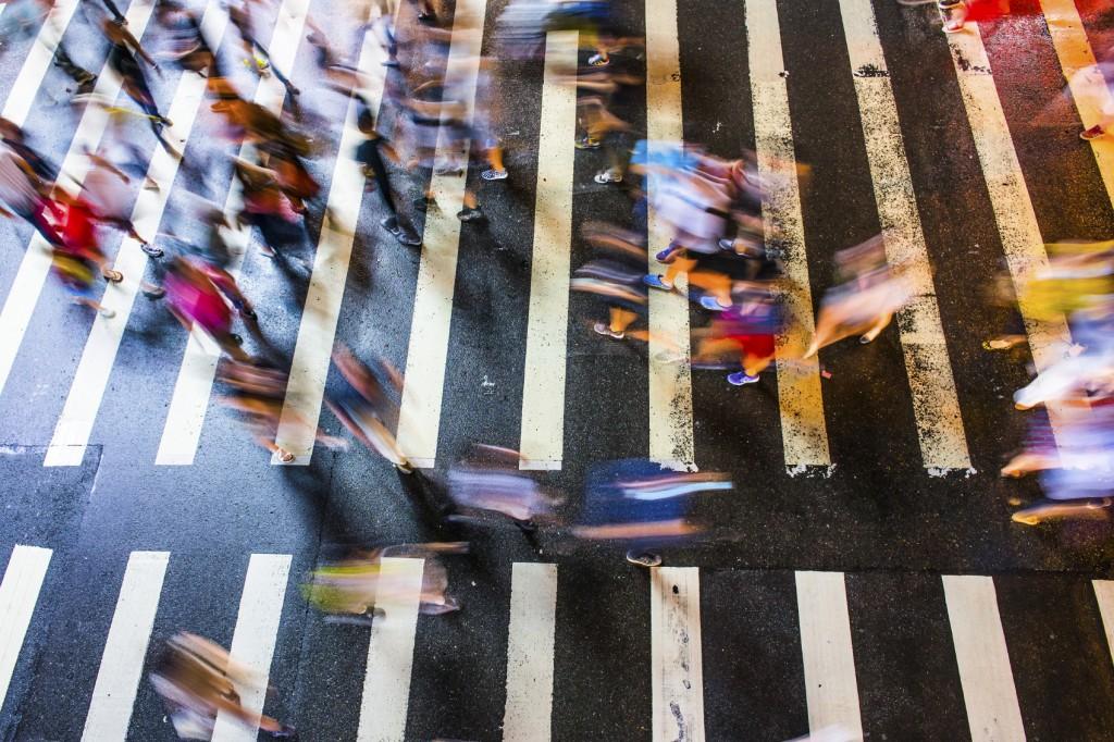 Pedestrians rushing across street