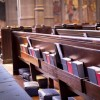 Church Pews within a Church, containing cushions, Hymn book and Bible