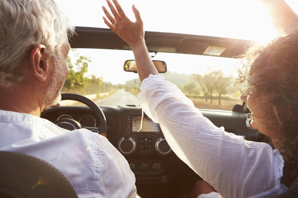 Find Similar Get a Comp Save to Lightbox Mature Couple Driving Along Country Road In Open Top Car
