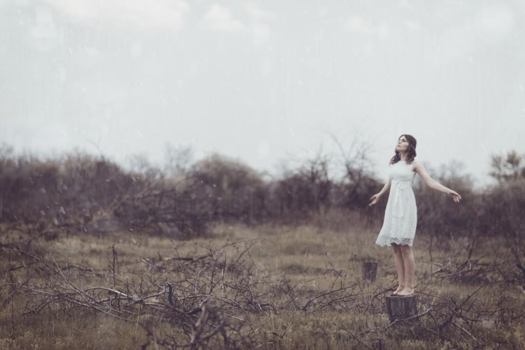Young girl standing in felled garden