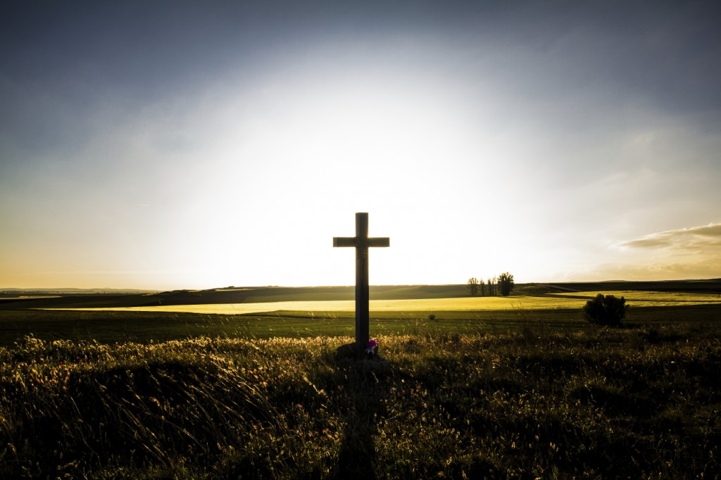 cross with sun rising behind