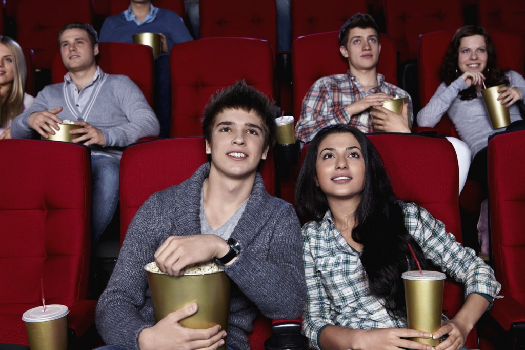 Young people watching movies in the cinema